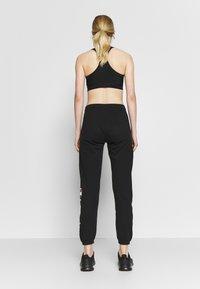 Champion Rochester - ELASTIC CUFF PANTS - Pantalones deportivos - black - 2