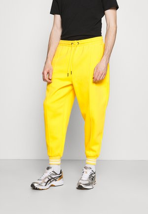 SIGNATURE - Tracksuit bottoms - yellow