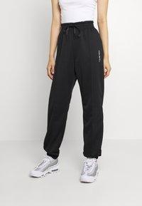 Nike Sportswear - TREND PANT - Tracksuit bottoms - black - 0