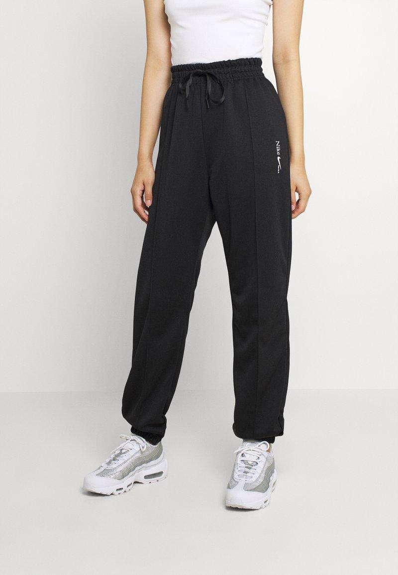 Nike Sportswear - TREND PANT - Tracksuit bottoms - black