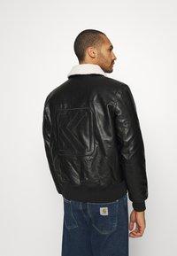 Karl Kani - RETRO JACKET - Faux leather jacket - black - 2