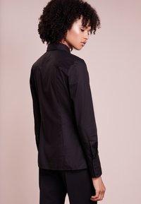 HUGO - ETRIXE - Button-down blouse - black - 2