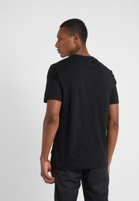 Versace Collection - GIROCOLLO REGOLARE - Print T-shirt - nero - 2