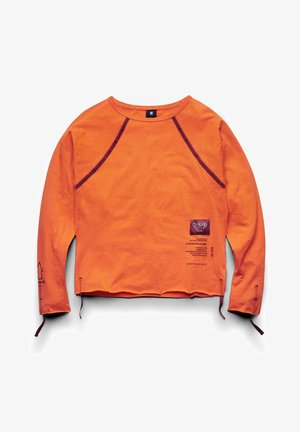 BATWING SMALL GRAPHICS - Long sleeved top - signal orange