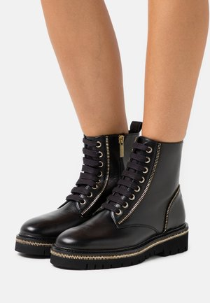 ZIP STREET - Lace-up ankle boots - black