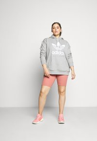 adidas Originals - TIGHT SPORTS INSPIRED HIGH RISE - Leggings - Trousers - light pink - 1
