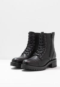Bullboxer - Platform ankle boots - black - 4