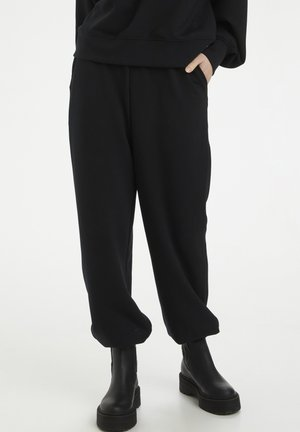 CHRISDAGZ - Tracksuit bottoms - black