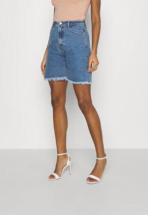 LONGLINE - Denim shorts - blue