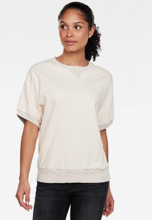 JASMASW - Camiseta estampada - nude