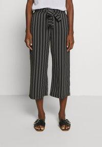 Cartoon - Trousers - black/white - 0