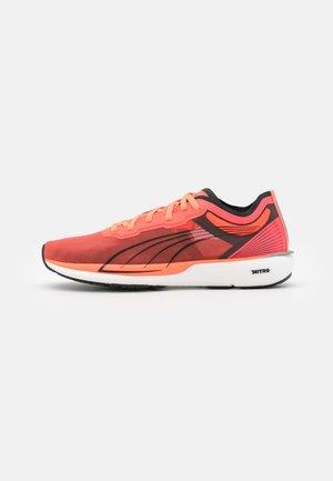 LIBERATE NITRO - Competition running shoes - lava blast/black