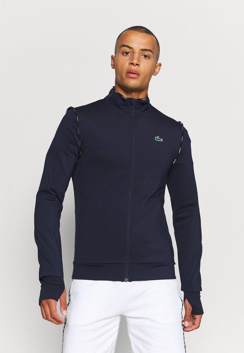 Lacoste Sport - TRACK JACKET - Training jacket - navy blue/white