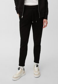 Marc O'Polo - Tracksuit bottoms - black - 0