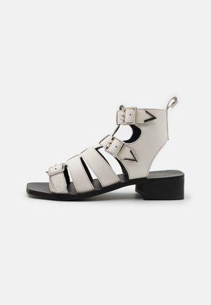 STELLA - Ankle cuff sandals - white
