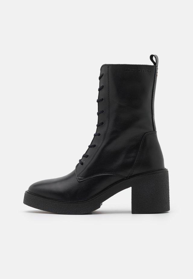 KANDY - Platform ankle boots - black