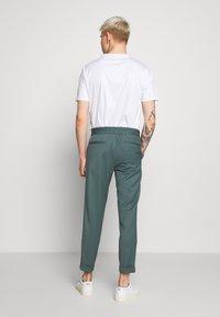 Filippa K - TERRY CROPPED PANTS - Trousers - dark mint powder - 2