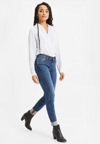 WE Fashion - Slim fit jeans - blue - 1