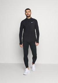 Nike Performance - SWIFT - Leggings - black - 1