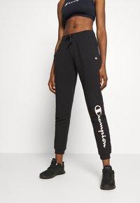 Champion - CUFF PANTS LEGACY - Teplákové kalhoty - black - 0