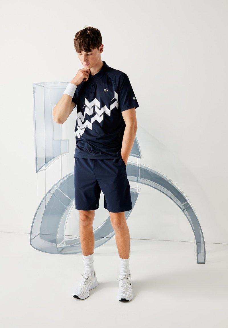 Lacoste Sport - Polo shirt - bleu marine / blanc