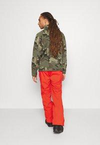 O'Neill - HAMMER SLIM PANTS - Zimní kalhoty - fiery red - 2