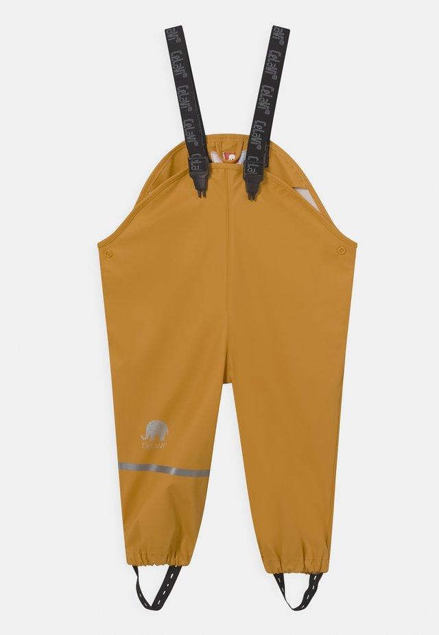 RAINWEAR PANTS SOLID UNISEX - Regenhose - mineral yellow