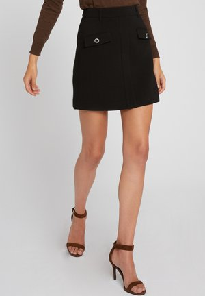 WITH BUTTONED FLAPS - A-line skirt - black