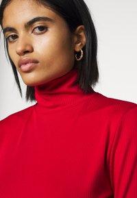 NA-KD - OPEN BACK HIGHNECK BODYSUIT - Long sleeved top - red - 3