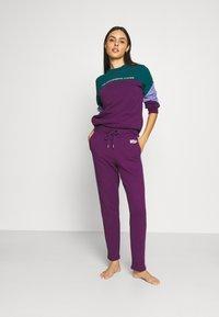 Diesel - ALINA TROUSERS - Pyjama bottoms - purple - 1