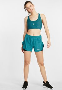 Skins - SKINS SPORT BH S3  - Sports bra - teal - 1