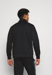 Jack & Jones Performance - JCOZTAPING TRACK SUIT - Chándal - black - 2