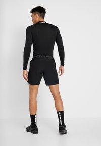 Nike Performance - FLEX REP SHORT - Urheilushortsit - black - 2