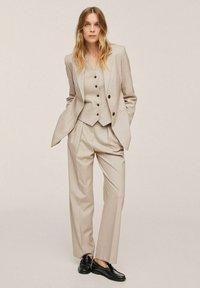 Mango - PLEATED - Trousers - beige - 1