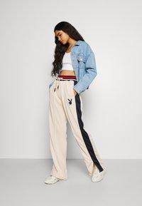 Missguided - PLAYBOY VARSITY WIDE LEG TRICOT PANTS - Pantalones deportivos - stone - 1