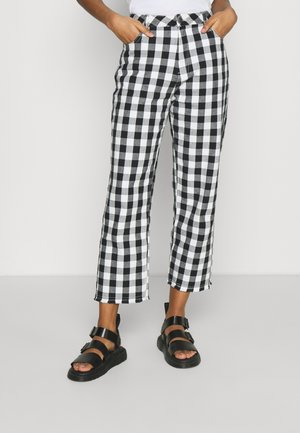 SHELBY - Trousers - black/white