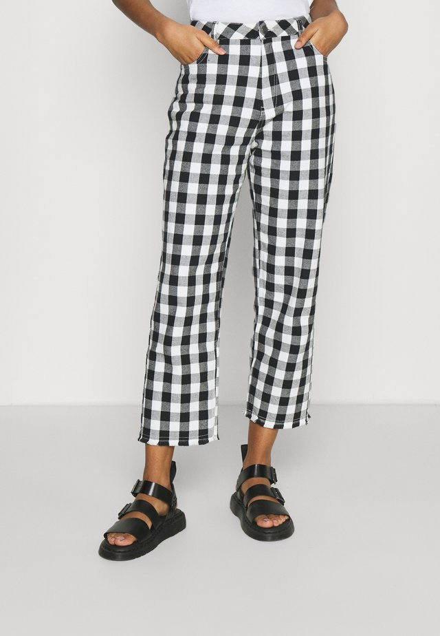 SHELBY - Pantaloni - black/white