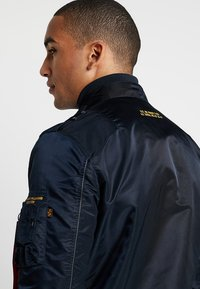 Alpha Industries - Bomber bunda - repl. blue - 4