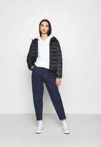 Tommy Jeans - TJW QUILTED TAPE HOODED JACKET - Light jacket - black - 1
