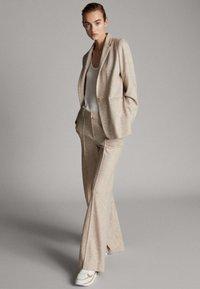 Massimo Dutti - MELIERTE  - Trousers - beige - 1