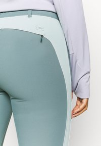 Under Armour - LINKS - Trousers - lichen blue - 5