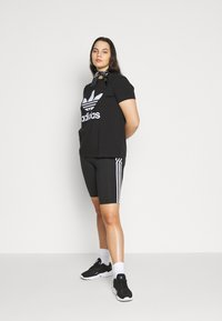 adidas Originals - TIGHT - Shorts - black/white - 1