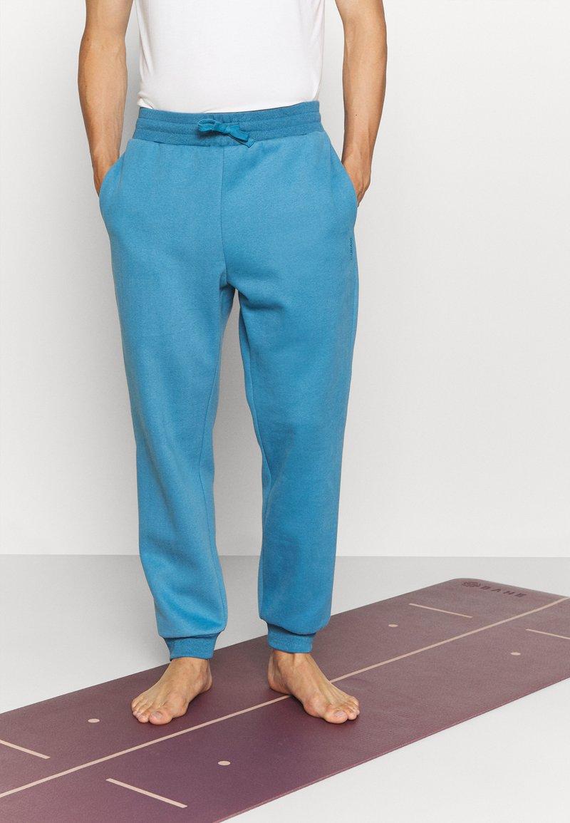 Curare Yogawear - LONG PANTS - Trainingsbroek - light blue