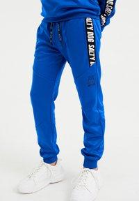 WE Fashion - SALTY DOG - Tracksuit bottoms - cobalt blue - 1