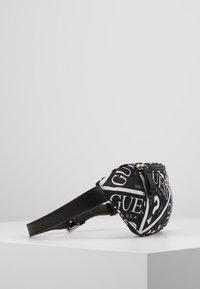 Guess - JUNIOR BUM BAG - Taška spříčným popruhem - jet black - 4