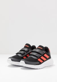 adidas Performance - TENSAUR RUN UNISEX - Neutral running shoes - core black/solar red/grey six - 3