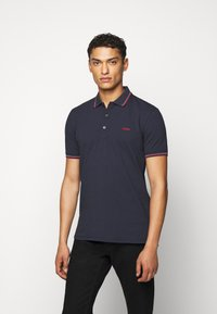HUGO - DINOSO - Polo shirt - dark blue - 0