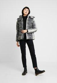 Urban Classics - LADIES HOODED PUFFER JACKET - Winter jacket - grey - 1