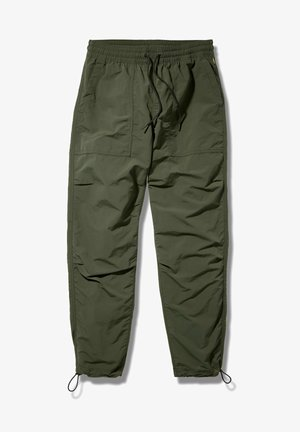 YC OUTDOOR ARCHIVE - Tracksuit bottoms - duffel bag