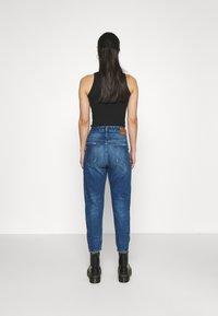 Diesel - D-FAYZA - Jeans Tapered Fit - medium blue - 2